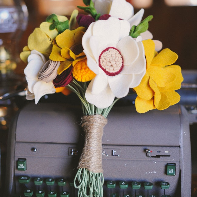 "Shannon wanted bouquets that would last long after the ceremony, so she found an artist on etsy.com and had her create a gorgeous felt bouquet in autumn colors. ""I still use my bouquet during the fall in our house as a table centerpiece,"" she says."