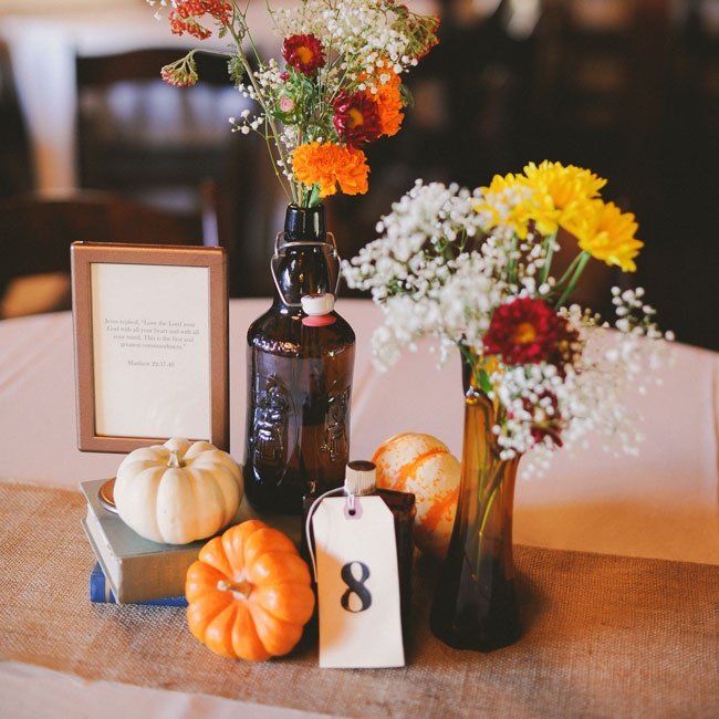 The centerpieces were a rustic grouping of old books, small pumpkins and amber bottles filled with wildflowers in autumn hues.