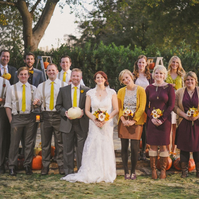 Shannon didn't make her bridesmaids wear matching gowns; instead she asked each to choose a dress that complemented the fall color palette. The groomsmen wore gray pants with mustard yellow ties and suspenders.