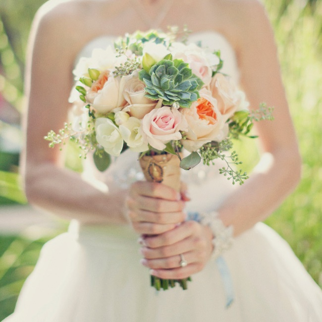 Soft peach garden roses, ivory gardenias and blush roses gave Allysa's bouquet a classic, romantic look, while lush green succulents and seeded eucalyptus added texture and depth.