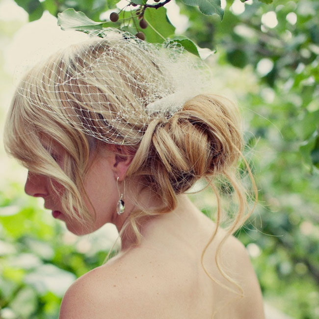 Allysa wore her hair in a low loose chignon with a simple bird cage veil for the ceremony.