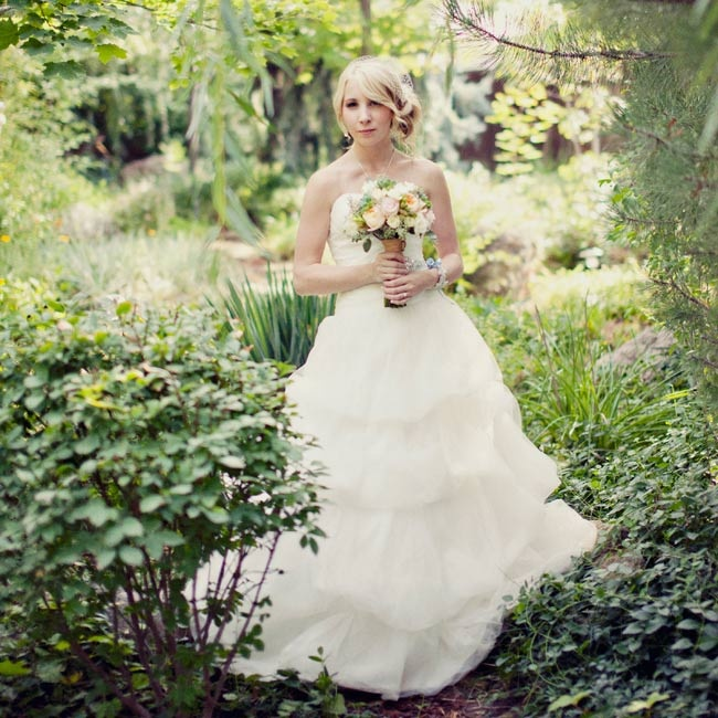 Alyssa chose a romantic strapless ball gown with a full layered organza skirt and beaded embellishments at the waist.