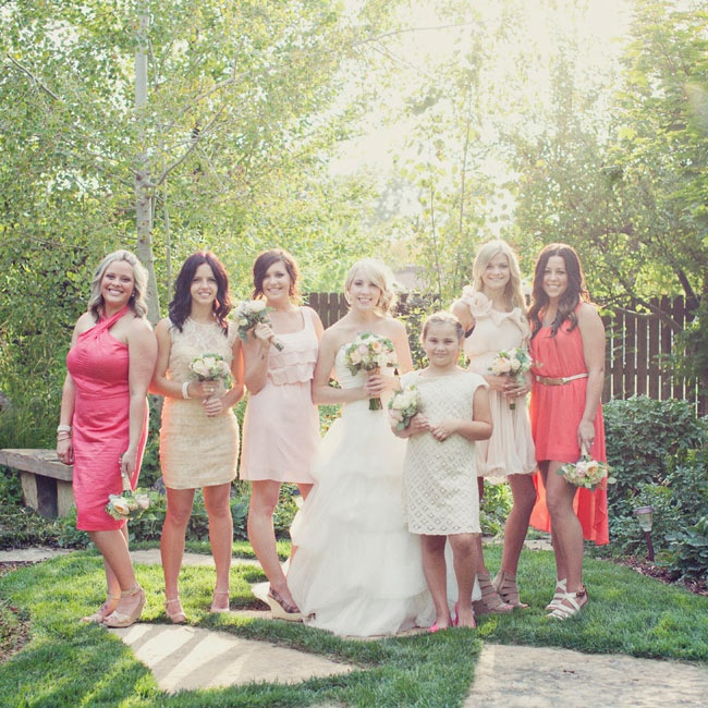 Allysa let her bridesmaids choose their own dresses in shades of pink, blush and ivory .