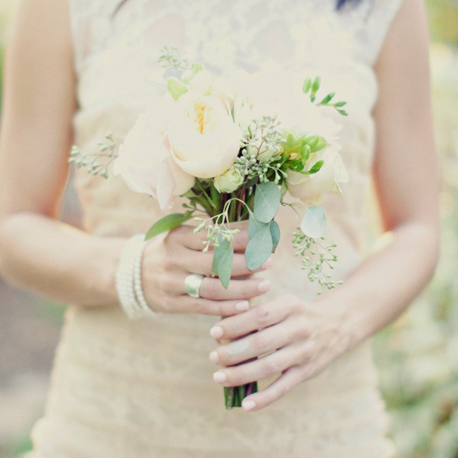 Soft ivory garden roses were accented with sprigs of seeded eucalyptus in each bridesmaid's bouquet.