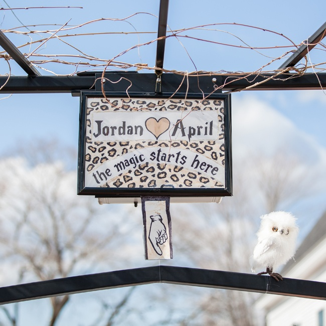 A fun leopard print sign welcomed guests as they arrived to the ceremony. To go with the whimsical Hogwarts-inspired theme, a white owl was perched on the top of the wrought iron gateway.