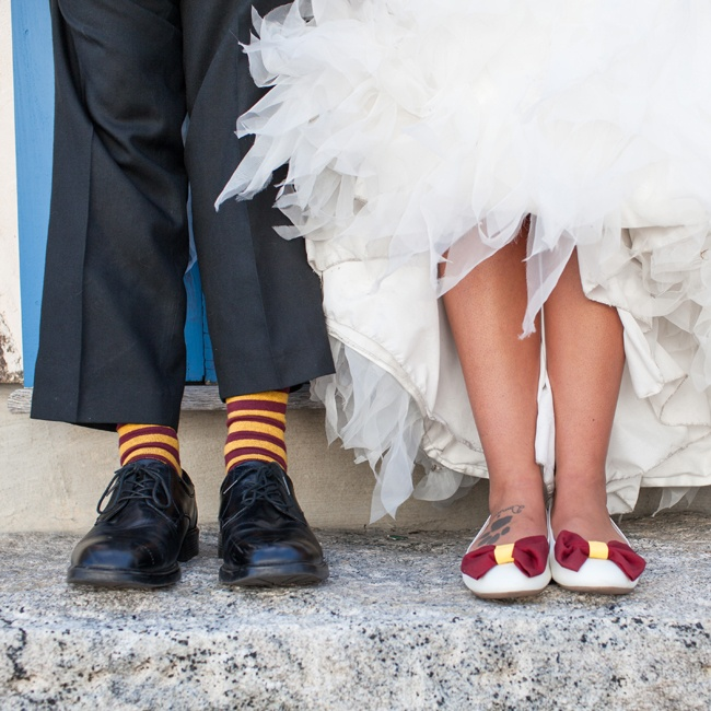 The couple showed off their Gryffindor pride with burgundy and yellow striped socks for Jordan and dainty bows for April's bridal flats.