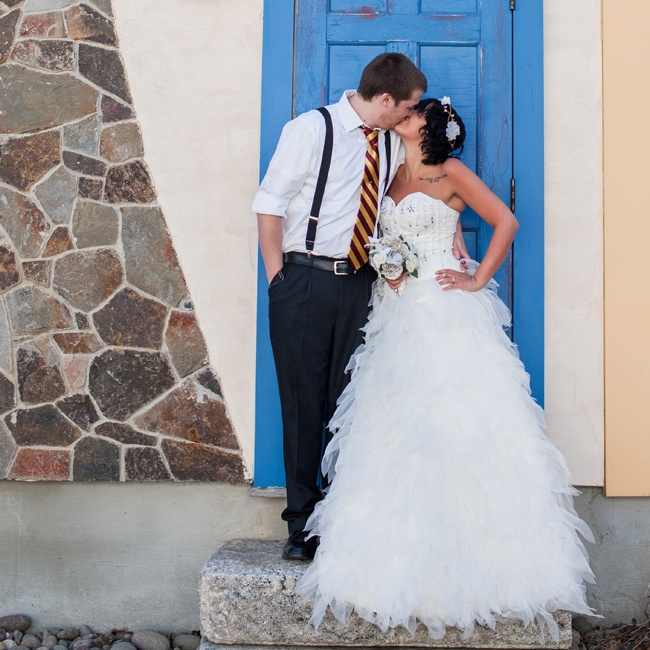 April's gown was a strapless A-line style with a beaded corset bodice and feathery tulle skirt that fit perfectly with her whimsical wedding theme.