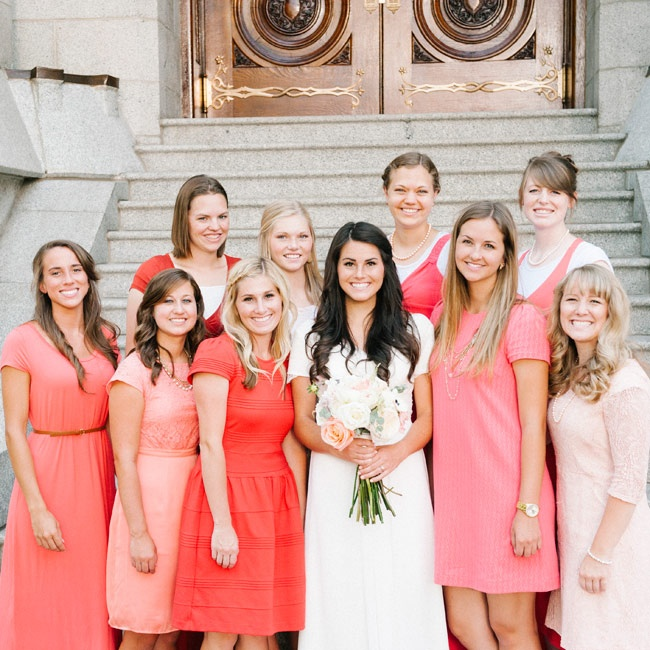 The bridesmaids were their own dresses in shades of pink, coral, red and blush for a fun ombre effect.