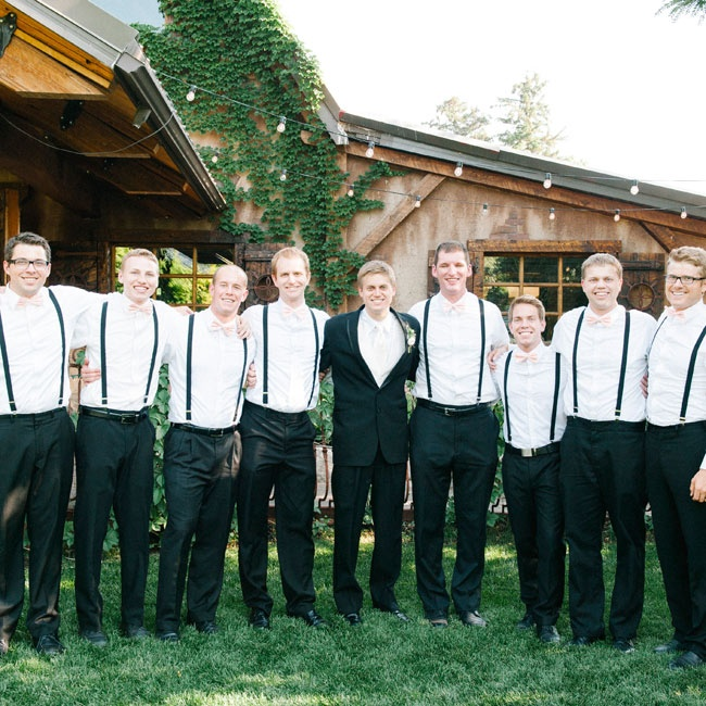 Blush bow ties and black suspenders were a fun quirky touch to the groomsmen's look.