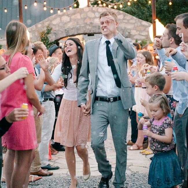 Instead of the traditional sparkler send off, family and friends sent the newlyweds off in a shower of bubbles.