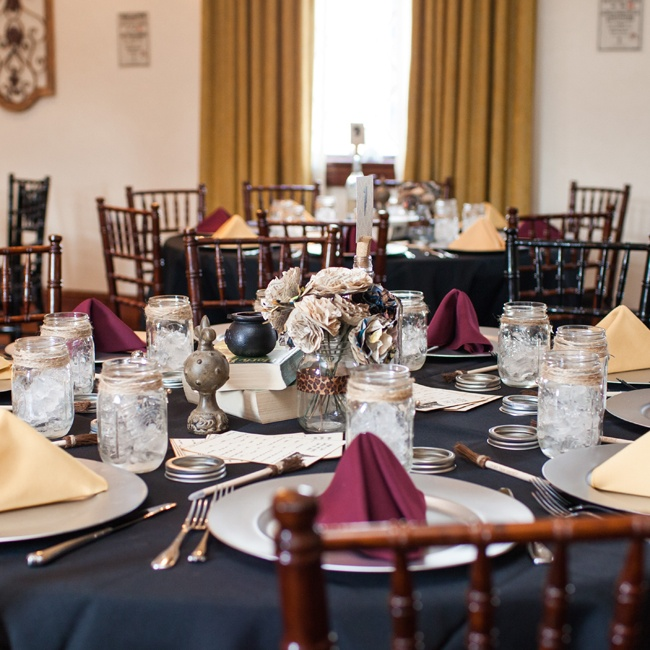 The reception tables were set with black linens, silver chargers and napkins in the Gryffindor colors.