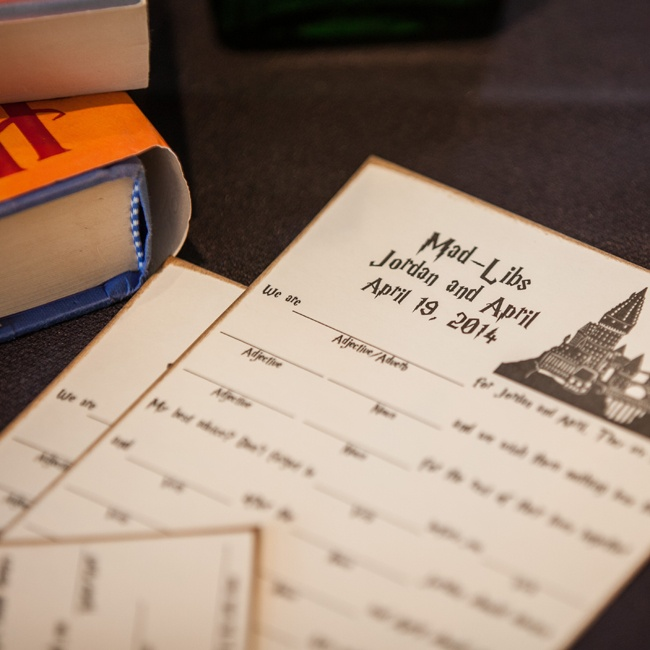 """April and Jordan put a fun twist on their advice cards with """"Mad Libs"""" printed on antiqued paper and with the same """"Hocus Pocus"""" font used on the series' books."""