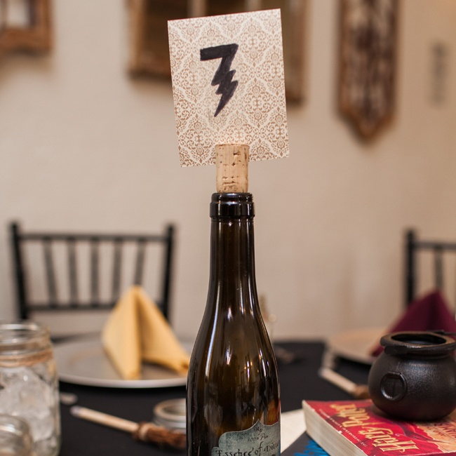 April made each of the table numbers herself with patterned papers and thunderbolt numbers.