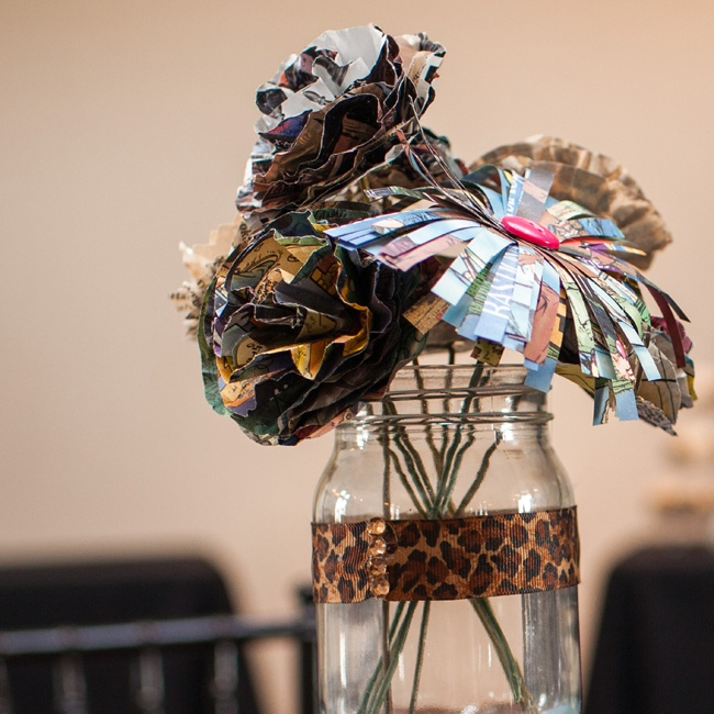 April handmade bouquets of comic book and paper back flowers for each table and arranged them in funky leopard print mason jars.