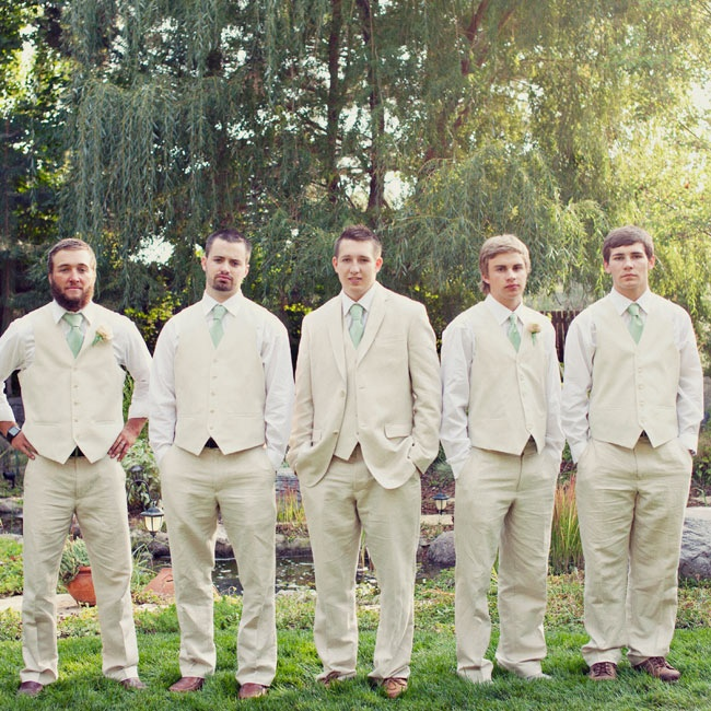 The guys wore cream colored dress pants and matching vests with crisp white button down shirts and sage colored ties.