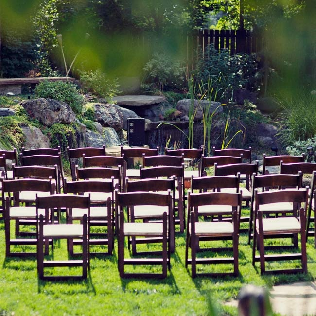 Simple wooden folding chairs were placed in the garden for the intimate ceremony.