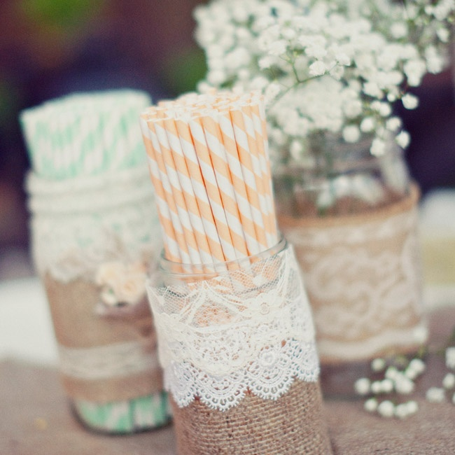 Green and yellow striped straws were displayed in burlap and lace wrapped mason jars.