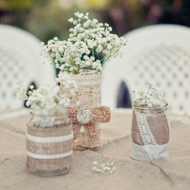 Baby's breath filled handmade burlap and lace wrapped mason jars for a rustic-yet-feminine look.