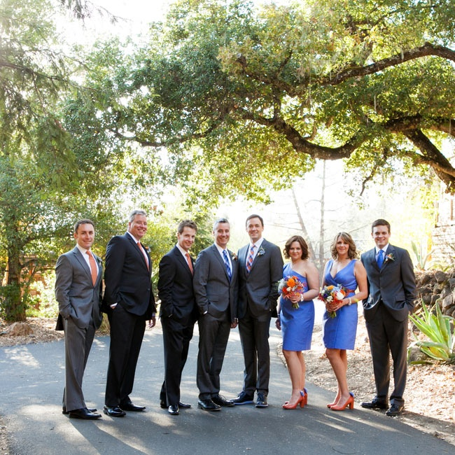 Chris's attendants wore blue dresses and ties, while Doug's groomsmen sported orange ties to balance their blue, orange and gray color scheme.