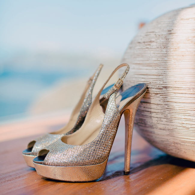 The bride walked down the aisle in style in these metallic, peep-toe Jimmy Choo heels.