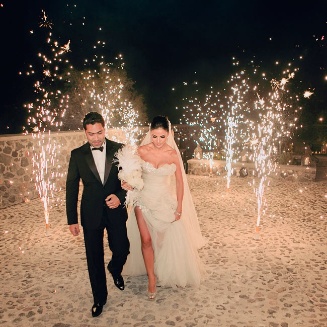 The newlyweds made a grand ceremony exit with fireworks lighting the way.
