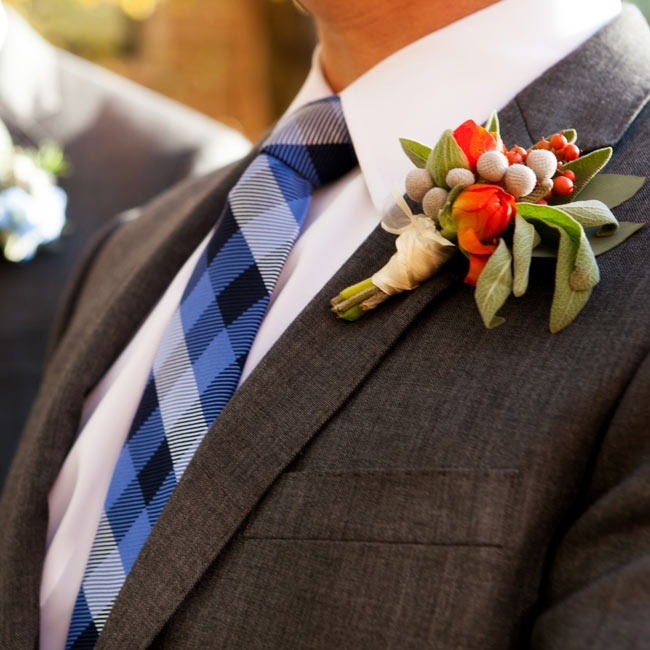 The couple wore similar tulip boutonnieres, Doug's in orange and Chris's in blue to contrast their plaid ties.