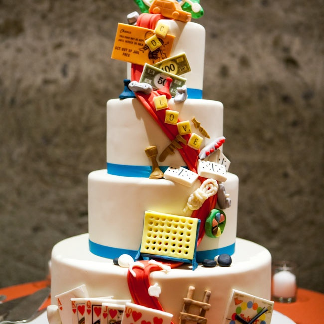 Doug and Chris love board games, so they incorporated their fun-loving personalities into their tiered wedding cake.
