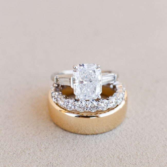 Jillian's shared prong diamond wedding band was the perfect complement to her engagement ring, an elongated radiant cut stone with tapered baguette diamonds. Jason kept things classic with a simple gold band.