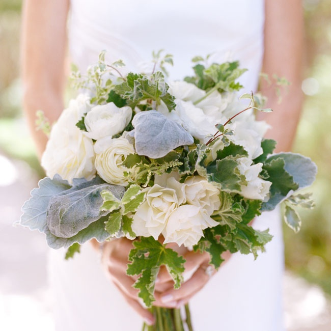 Jillian carried a hand-tied bouquet of ivory ranunculuses, garden roses, lamb's ear and variegated greenery that felt effortlessly romantic.
