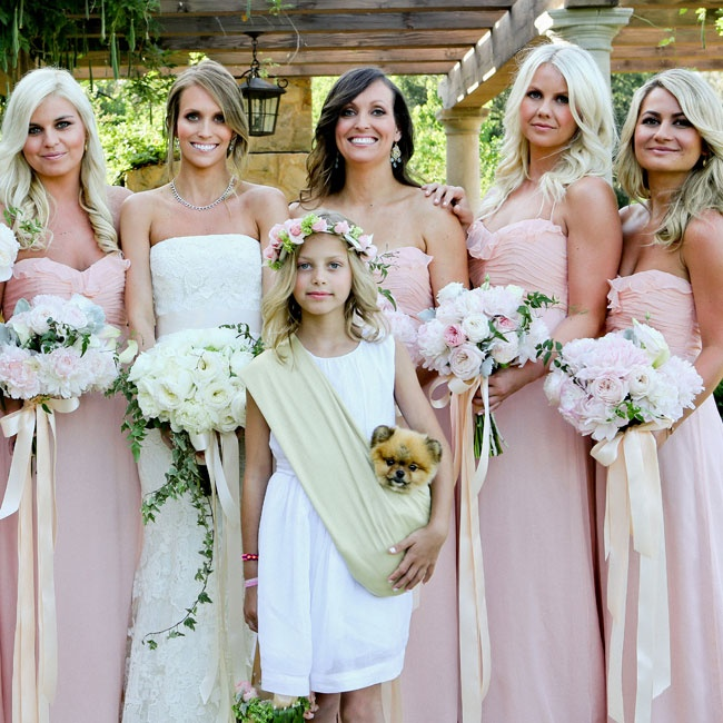 The bridesmaids wore long Amsale gowns with ruffled sweetheart necklines in light shade of pink. The girls wore their hair down in long loose curls for a simple-yet-romantic look.