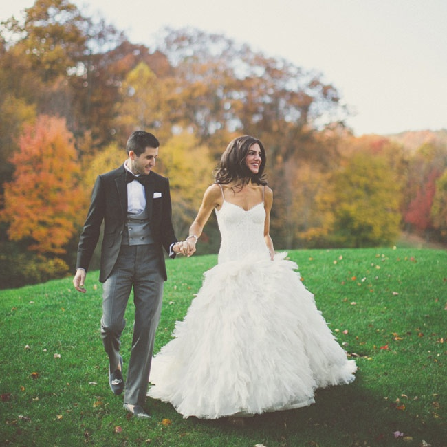 The contrast between the lace bodice and feather train on this Monique Lhuillier wedding gown caught Amanda's eye.