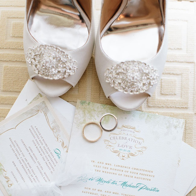 "Renee found her stationery on Wedding Paper Divas. The invitations had a traditional look with formal typeface and a subtle ""Secret Garden"" theme. For a more embellished look, Renee pasted the details card to ivory cardstock and sealed each envelope with a wax seal."