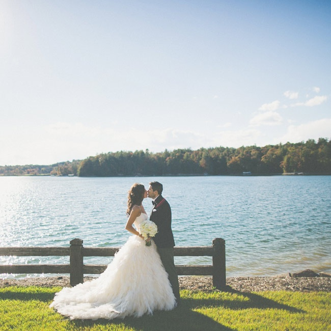 "The couple chose The Cliffs at Keowee Vineyards because Amanda's family has a vacation home on the same lake. ""It's a tranquil escape from Manhattan and offers surreal views of both the mountain and the lake,"" Pete says."