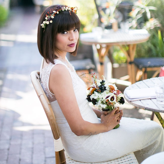 Jackie wanted her bridal look to have a bohemian chic vibe. She decided to wear her hair down, opting for a simple blow out, and accessorized with a simple, rustic flower crown.