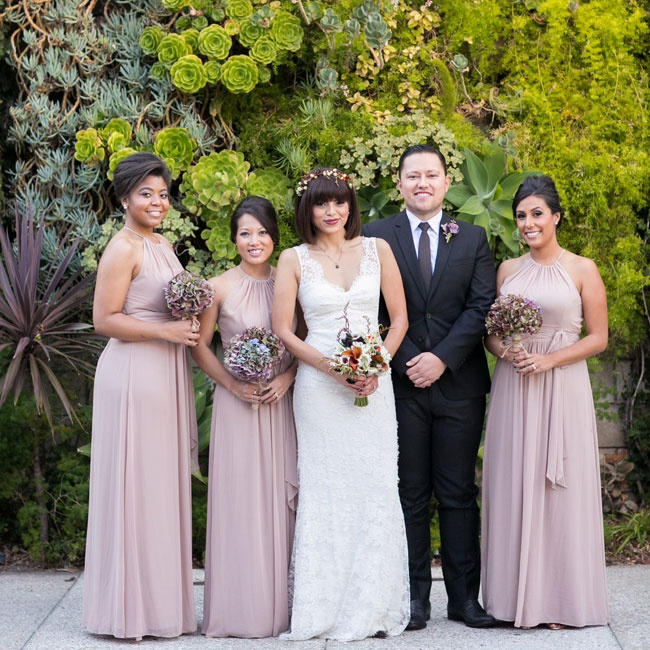 The bridesmaids wore floor-length gowns in a muted shade of blush. The dresses had halter necklines and were tied at the waist with a simple sash in the same hue.