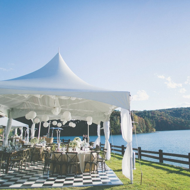 """The reception was backdropped by the lake, so...we wanted to keep our motif rustic, yet chic and elegant,"" the bride says."