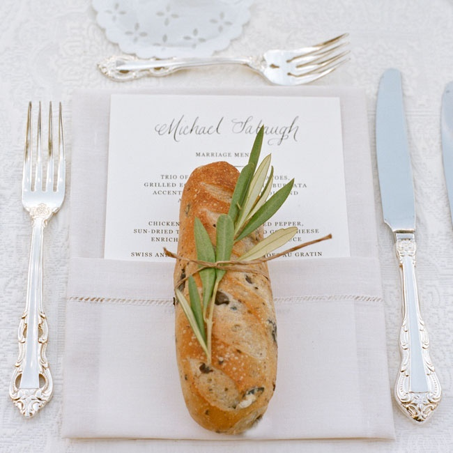 Small loaves of olive bread wrapped with sprigs of rosemary were placed at each place setting.