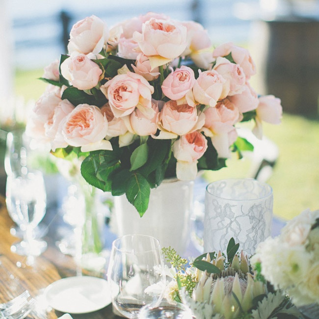 The bride and groom asked for centerpieces in soft pink, ivory and white to add drama to the tables while maintaining their neutral color scheme.