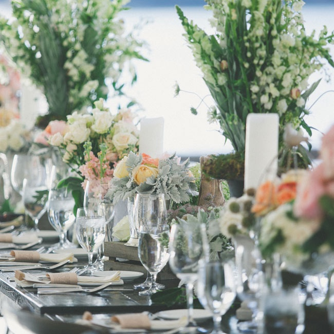 The lush floral centerpieces and wooden tables gave the reception space a rustic yet elegant look.