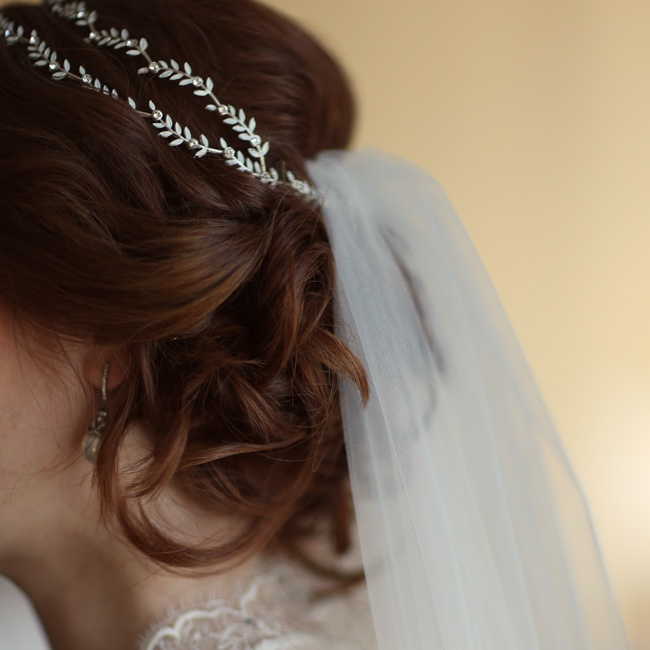 Briana wanted her hair to look natural, so she wore her hair curled and loosely pinned up to highlight the lace back of her gown.