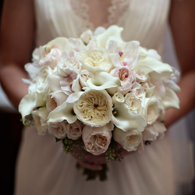 Briana carried a soft and romantic bouquet of blush and ivory garden roses, calla lilies and orchids.