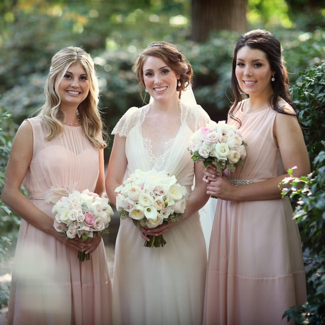 The pastel pink of the dresses complemented both of the bridesmaids' complexions, and each accessorized her dress with a broach on the waist of the dress.