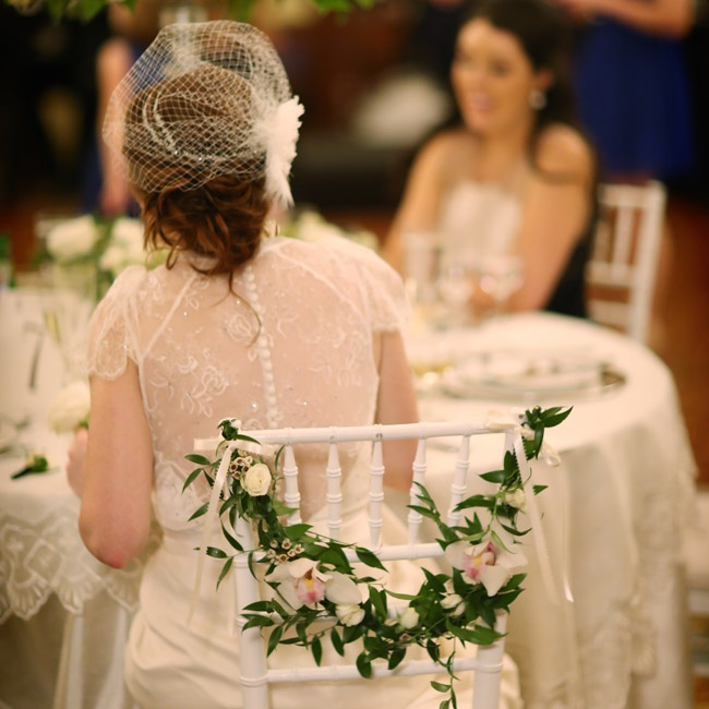 After the ceremony, Briana donned a birdcage veil with a gorgeous feather fascinator on the side.