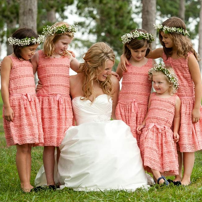 Kate found lace dresses at Gap that were just a shade lighter than the bridesmaid dresses, and then added baby's breath crowns for the flower girls to wear.