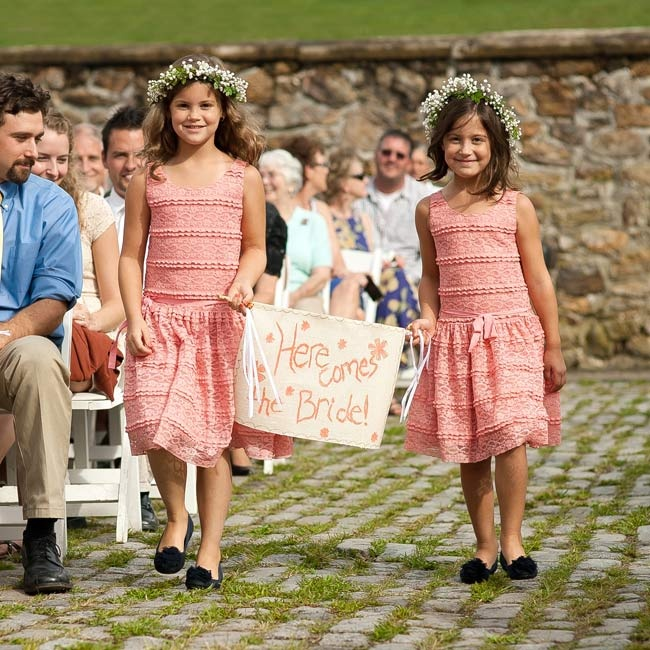 Two of the child attendants carried a small sign announcing that the bride was on her way.