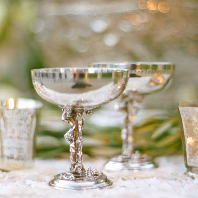The couple incorporated special family heirlooms into their reception decor, including silver champagne coupes.