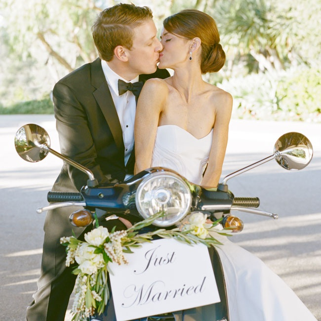 "On her 24th birthday, Jillian received a midnight blue Vespa from Jason as a gift. They felt it was only appropriate to make their grand exit via the speedy scooter, which they decorated with fresh florals and a ""Just Married"" sign."