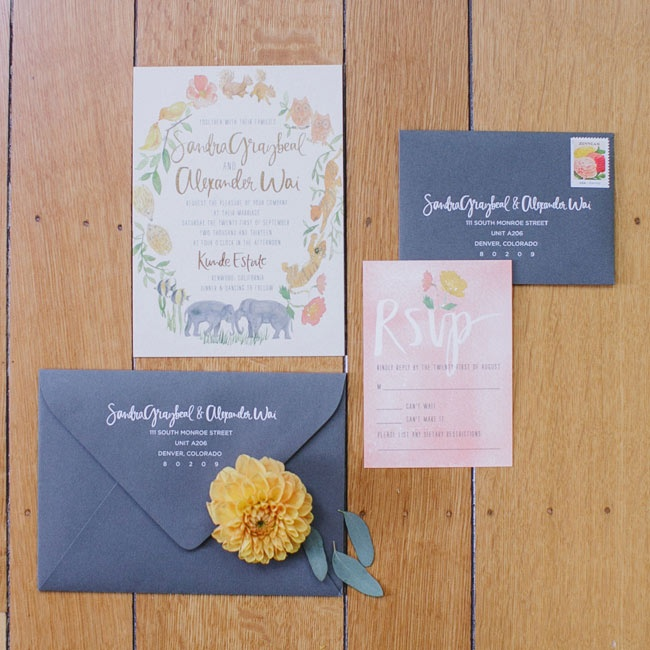 Watercolored invitation with a floral motif was sent out to prospective guests in a slate blue envelope.