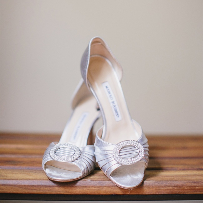 Sandra wore these peep-toe metallic heels with an oval embellishment down the aisle at her ceremony.