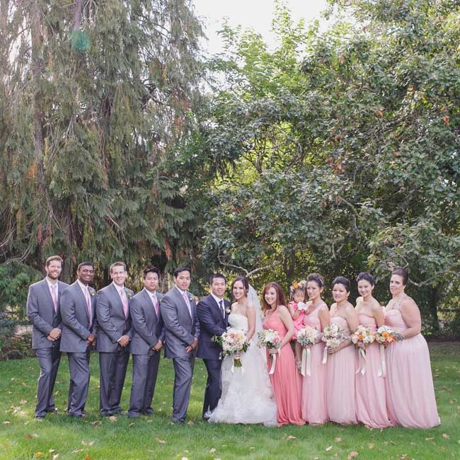 The bridesmaids wore blush floor-length gowns, while groomsmen wore gray suits.